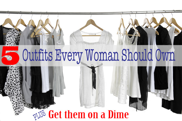 Set of fashion female clothing hanging on hangers
