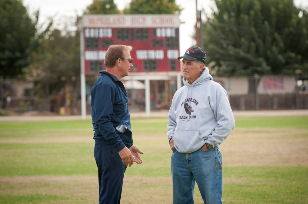 McFARLAND, USA..L to R: Kevin Costner (Coach Jim White) and real-life Coach Jim White on set of McFarland, USA.  ..Ph: Ron Phillips..©Disney 2015