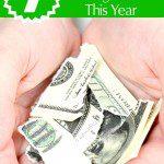 Dollar bill in child hand